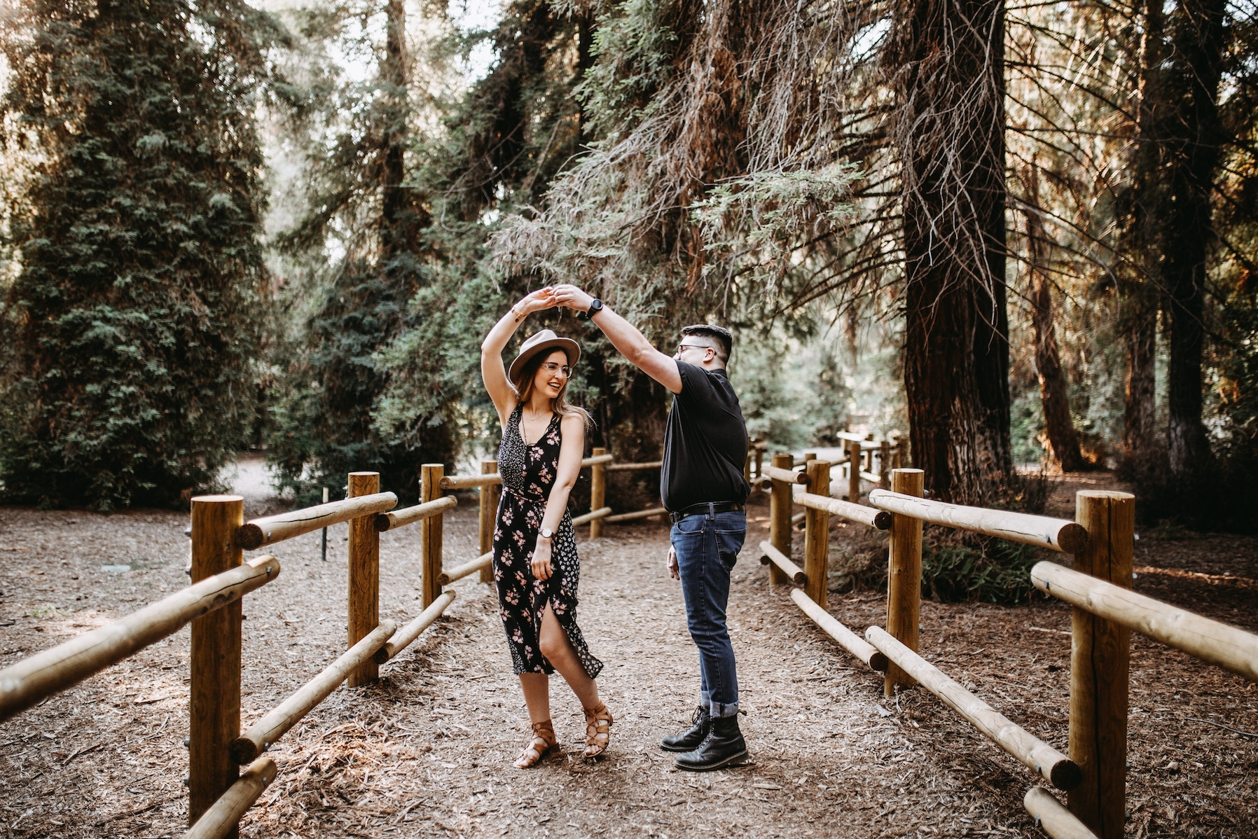 couple dancing in the woods